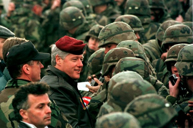 President Bill Clinton dons the red beret of the Red Eagles as he speaks with U.S. Troops stationed as part of a NATO peacekeeping force on January 13, 1996, in Tuzla, Bosnia. On April 4, 1949, representatives of 12 nations gathered in Washington to sign the North Atlantic Treaty, creating the NATO alliance. File Photo by Mike Marucci/UPI