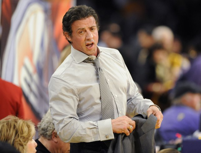 Actor Sylvester Stallone is takes off his jacket at an NBA basketball game between the Los Angeles Lakers and the Cleveland Cavaliers in Los Angeles on December 25, 2009. UPI Photo/ Phil McCarten