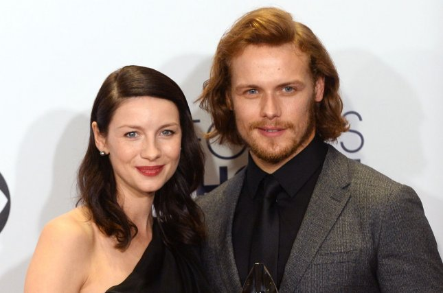 Caitriona Balfe, left, and Sam Heughan pose backstage with the award for favorite cable sci-fi/fantasy TV show at the 41st annual People's Choice Awards at the Nokia Theatre in Los Angeles on Jan. 7. File Photo by Jim Ruymen/UPI