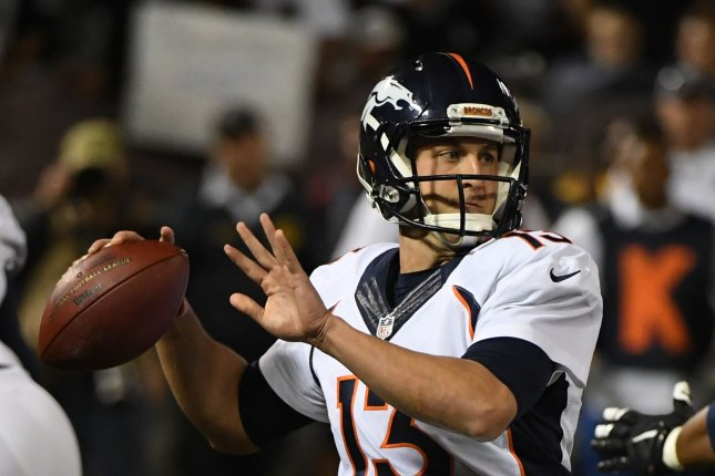 Denver Broncos QB Trevor Siemian (13) throws in the first quarter against the Oakland Raiders at the Oakland-Alameda County Coliseum in Oakland, California on November 6, 2016. Siemian and the Broncos lost to the Raiders 30-20. Photo by Terry Schmitt/UPI