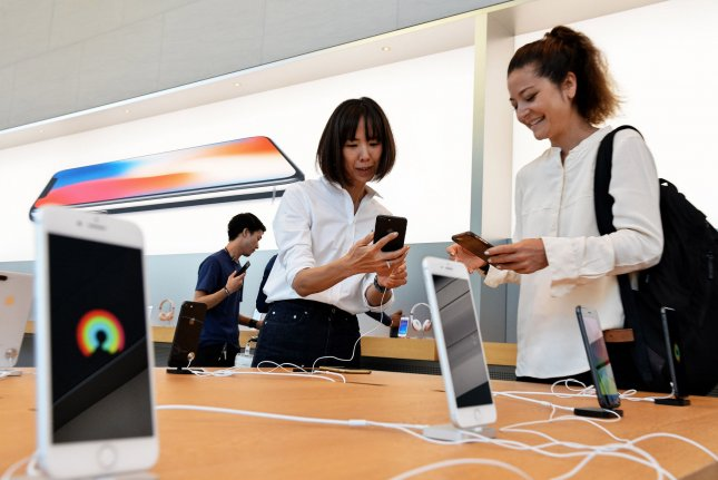 Customers try out the new Apple iPhone 8 at the Apple store in Omotesando in Tokyo, Japan on September 22, 2017. Apple's market value is down nearly $50 billion since the company unveiled the new iPhones earlier this month. Photo by Keizo Mori/UPI