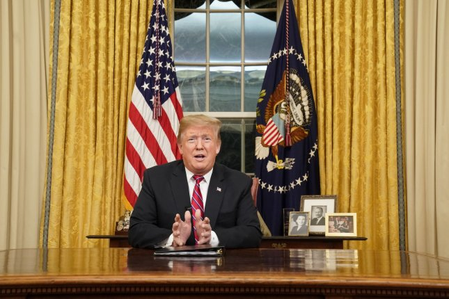 President Donald Trump delivered his first primetime address from the Oval Office of the White House on Tuesday, calling for funding for a barrier along the U.S.-Mexico border. Photo by Carlos Barria/UPI