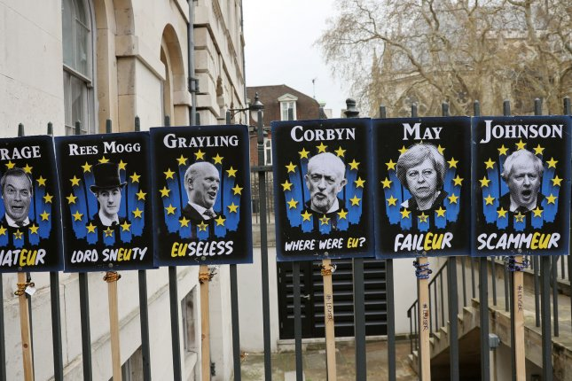 Placards of leading figures in the Brexit crisis are seen on April 3 outside the Houses of Parliament in London, Britain. File Photo by Hugo Philpott/UPI