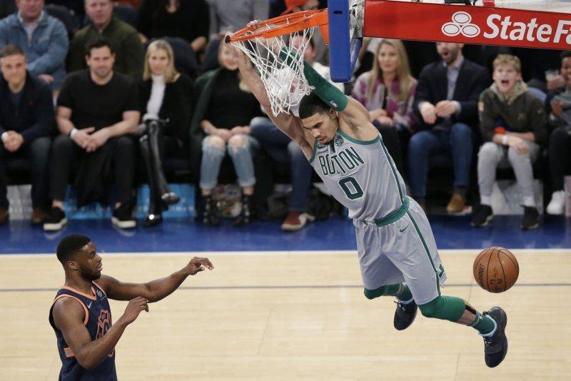 Boston Celtics forward Jayson Tatum suffered an ankle injury against Turkey on Tuesday night. File Photo by John Angelillo/UPI