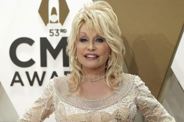 Dolly Parton recreated the photo shoot for her 1978 Playboy cover while celebrating her husband Carl Thomas Dean's 79th birthday.File Photo by John Angelillo/UPI