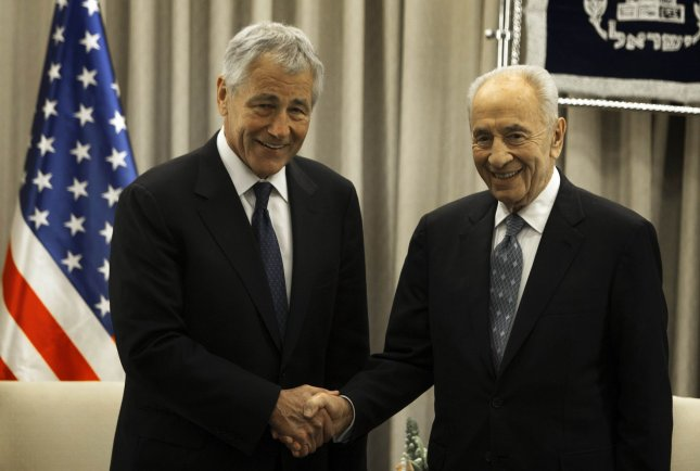 U.S. Secretary of Defense Chuck Hagel (L) shakes hands with Israeli President Shimon Peres at the President's office in Jerusalem on April 22, 2013. Hagel arrived in Israel at the start of a six-day regional tour, his first since taking over as Pentagon chief two months ago. UPI/Menahem Kahana/Pool
