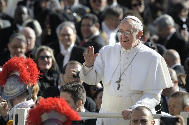 Pope Francis waves from the papamobile as he arrives for his inauguration mass at the Vatican at St Peter's Square on March 19, 2013. UPI/Stefano Spaziani