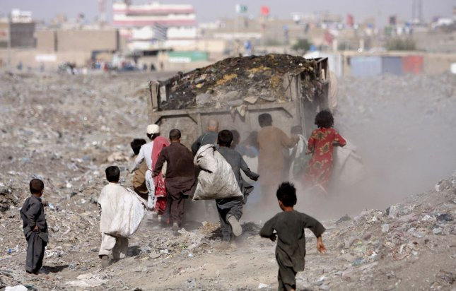 In this photo taken on August 30, 2013, young Afghan refugees collect scraps of paper and plastic at the local garbage dump, in the Pakistani town of Chaman, which shares a border with Afghanistan. Mostly they look for things they can burn as fuel for cooking. UPI/Matiullah.