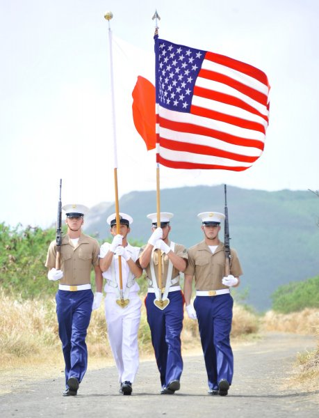 Servicemen from the United States and Japan walk together during the Battle of Iwo Jima 68th anniversary ceremony on the Japanese Island March 13, 2013. File Photo by Keizo Mori/UPI