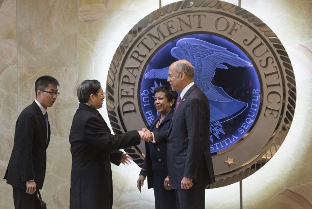U.S. Attorney General Loretta E. Lynch and Homeland Security Secretary Jeh Johnson on Tuesday greet State Councilor and Minister of Public Security Guo Shengkun of China prior to a meeting on cyber security and related issues at the Department of Justice headquarters in Washington, D.C. Photo by Kevin Dietsch/UPI.