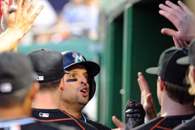 Miami Marlins third baseman Martin Prado (14) is congratulated in the dugout following his two run home run against the Washington Nationals in the first inning at Nationals Park in Washington, D.C. on September 17, 2015. Photo by Mark Goldman/UPI