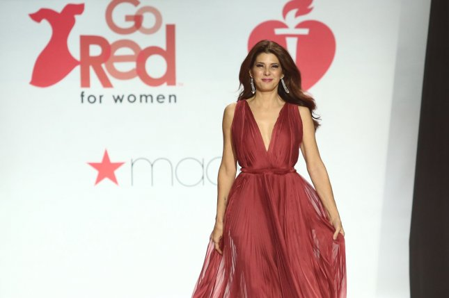Marisa Tomei walks on the runway at The American Heart Association's Go Red For Women Red Dress Collection 2018 fashion show presented by Macy's at the Hammerstein Ballroom on February 8 in New York City. Photo by Serena Xu-Ning/UPI