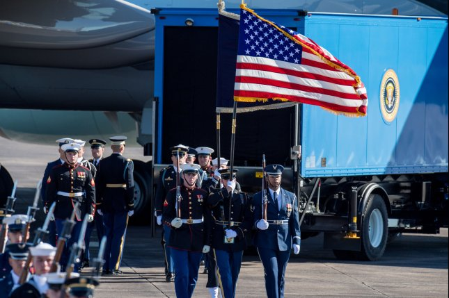 A military honor guard leaves the tarmac Monday after the casket of former President George H. W. Bush was put on a plane at Ellington Field in Houston for a trip to Washington, D.C. Photo by Trask Smith/UPI