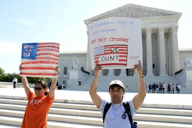 Demonstrators march in front of the Supreme Court, on its final day in session, on Capitol Hill on Thursday. Photo by Mike Theiler/UPI