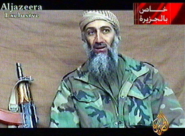 WAX2001122601 - 26 DECEMBER 2001 - WASHINGTON, DC, USA: In this image made from video broadcast by the Qatar-based television station Al-Jazeera on Wednesday, Dec. 26, 2001, Osama Bin Laden speaks from an undisclosed location at an undisclosed time. His statements indicated he was speaking in the first half of December. Writing at top right reads Exclusive to Al-Jazeera. .mk/aa/UPI via Al-Jazeera