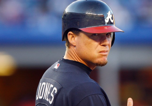 Atlanta Braves Chipper Jones stands on first base after walking in the first inning against the New York Mets at Shea Stadium in New York City on August 19, 2008. (UPI Photo/John Angelillo) .