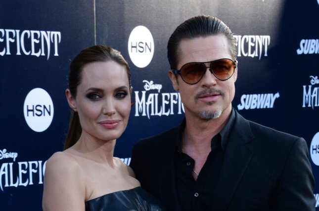 Angelina Jolie (L) with husband Brad Pitt at the Los Angeles premiere of 'Maleficent' on May 28, 2014. The couple surprised fans by making an impromptu Subway run Saturday. File photo by Jim Ruymen/UPI