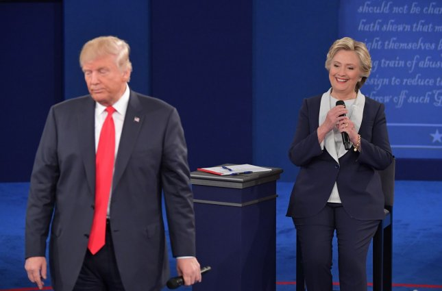 Republican presidential candidate Donald Trump listens to Democratic presidential candidate Hillary Clinton during the presidential debate at Washington University in St. Louis on October 8, 2016. Clinton continues to expand her lead in the UPI/CVoter tracking poll. Photo by Kevin Dietsch/UPI