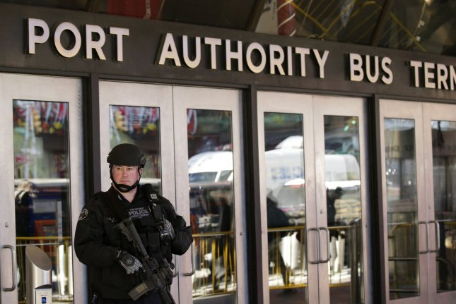 An NYPD Port Authority Police Counter-Terrorism Unit officer guards the 8th Avenue entrance that is still closed to the public. Photo by John Angelillo/UPI