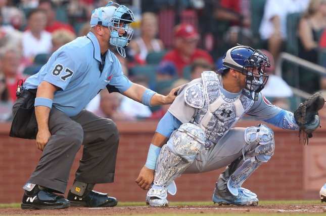 Home plate umpire Scott Barry and Chicago Cubs catcher Willson Contreras prepare for a pitch to the St. Louis Cardinals in the first inning on June 17 at Busch Stadium in St. Louis. Photo by Bill Greenblatt/UPI
