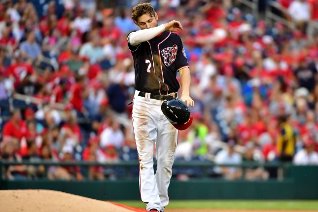 Washington Nationals shortstop Trea Turner walks off the field after being tagged out stealing second against the Miami Marlins in the fourth inning on July 6 at Nationals Park in Washington, D.C. Photo by Kevin Dietsch/UPI