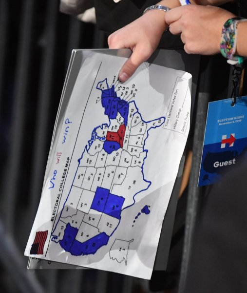 A campaign worker holds an electoral map at the Javits Center in New York City on election night, November 8, 2016. File Photo by Kevin Dietsch/UPI