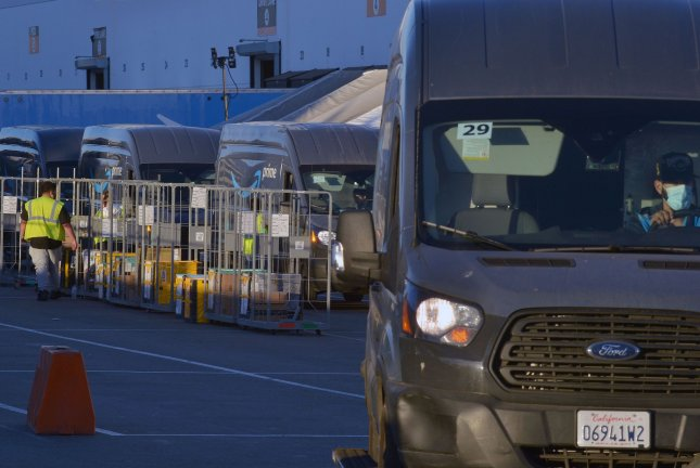 Delivery trucks line up at an Amazon facility in Hawthorne, California, on December 15, 2020. File photo by Jim Ruymen/UPI