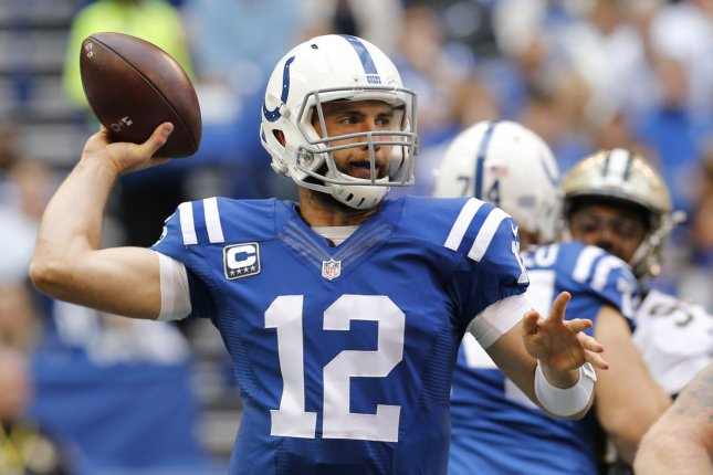 Indianapolis Colts quarterback Andrew Luck (12) throws under pressure from the New Orleans Saints during the first half of play at Lucas Oil Stadium in Indianapolis, Indiana, October 25, 2015. Photo by John Sommers II/UPI