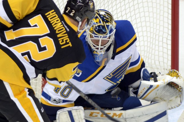 St. Louis Blues goalie Carter Hutton (40) blocks the shot of Pittsburgh Penguins right wing Patric Hornqvist (72) in the second period of the Blues 3-0 win against the Pittsburgh Penguins at the PPG Paints Arena in Pittsburgh on January 24, 2017. Photo by Archie Carpenter/UPI