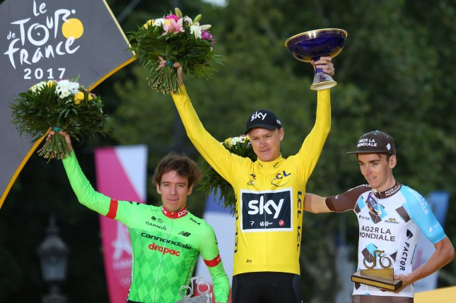 Rigoberto Uran of Colombia (L), Chris Froome of Great Britain (C) and Romain Bardet of France arrive on the presentation podium after the conclusion of the Tour de France in Paris on July 23, 2017. Froome claimed his fourth overall Tour victory. Photo by David Silpa/UPI