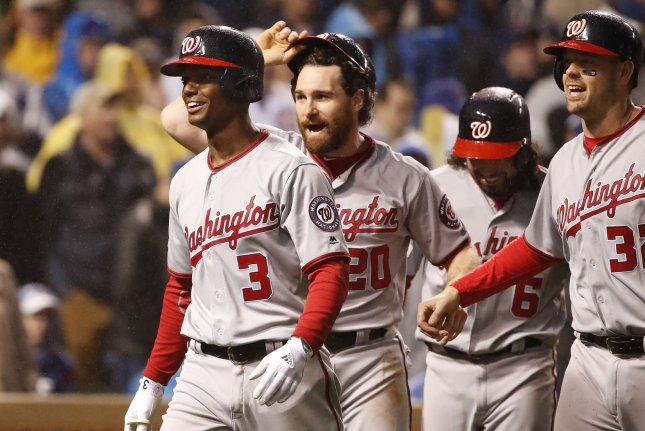Washington Nationals' Michael Taylor (3) celebrates with teammates Daniel Murphy (20), Anthony Rendon (6), and Matt Wieters (32) after his grand slam home run against the Chicago Cubs on Wednesday during the eighth inning of the NLDS Game 4 at Wrigley Field in Chicago, Ill. Photo by Kamil Krzaczynski/UPI
