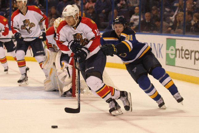 St. Louis Blues forward Vladimir Tarasenko tries to slow Florida Panthers forward Aleksander Barkov in the second period on December 1, 2015 at the Scottrade Center in St. Louis. File photo by Bill Greenblatt/UPI