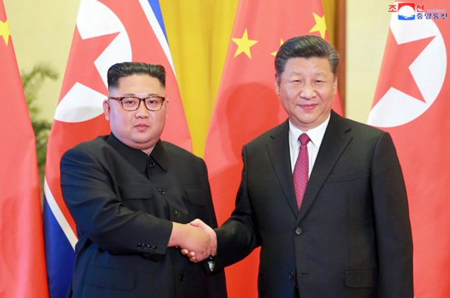 This image released by the North Korean Official News Service (KCNA) shows North Korean leader Kim Jong Un visiting Chinese President Xi Jinping in Beijing last year to discuss the denuclearization of the Korean Peninsula. File Photo by KCNA/UPI