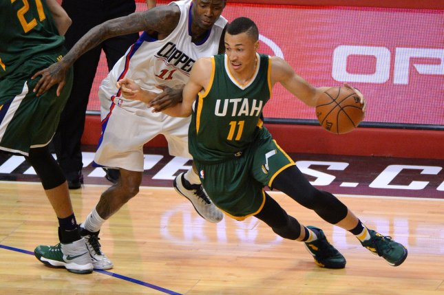 Utah Jazz guard Dante Exum (R) was the No. 5 overall pick in the 2014 NBA Draft. File Photo by Jon SooHoo/UPI