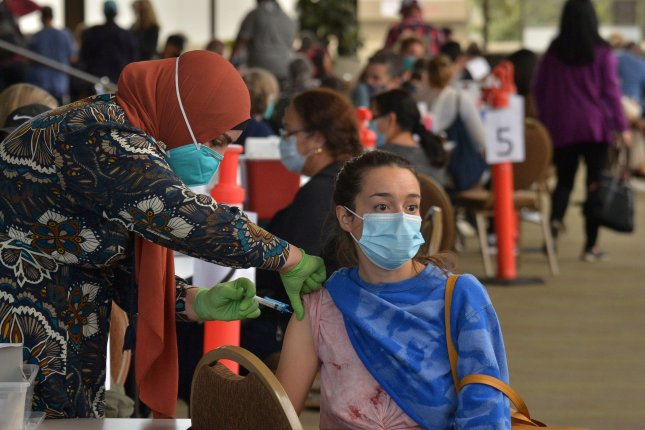 A health worker administers a COVID-19 vaccination to a local resident at the Long Beach Convention Center in Long Beach, California, on March 8, 2021. File photo by Jim Ruymen/UPI