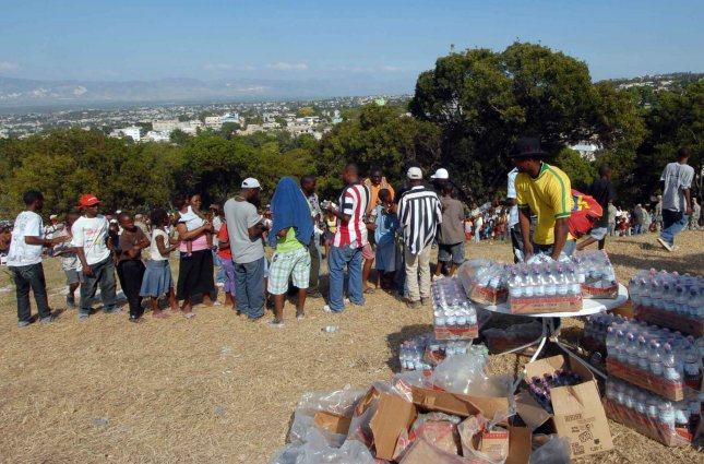 U.S. military members distribute food and water to Haitian citizens in Port-Au-Prince on January 17, 2010, that were affected by the 7.0 magnitude earthquake on Jan. 12, 2010. UPI//US Navy