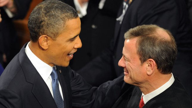U.S. President Barack Obama shakes hands with Supreme Court Chief Justice John Roberts as he enters the House Chamber to deliver his State of the Union address on Jan. 25, 2011. -- UPI/Pat Benic