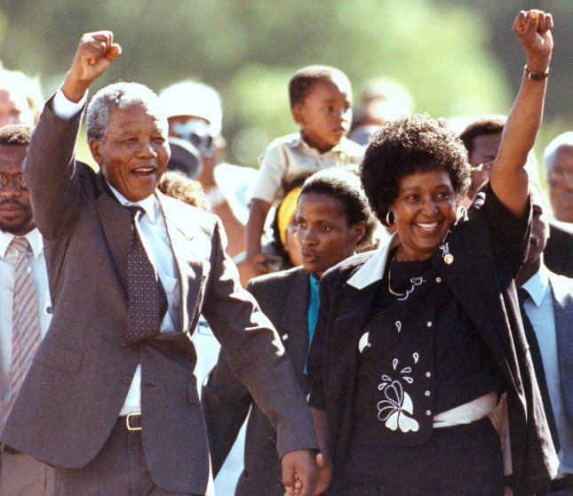 Nelson Mandela (L) and his wife Winnie salute supporters after the anti-apartheid activist was freed after 27 years in prison on February 11, 1990. UPI File Photo