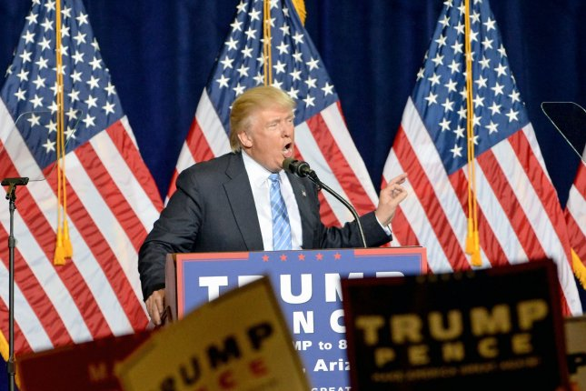 Donald Trump talks about his immigration policy at the Phoenix Convention Center on Wednesday. Trump reiterated many of his longstanding policies on illegal immigration. Photo by Art Foxall/UPI