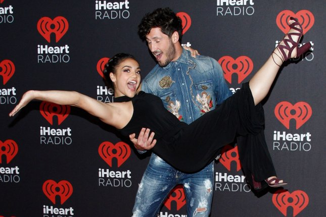 Olympic gymnast Laurie Hernandez and Val Chmerkovskiy arrive for the iHeartRadio Music Festival at the T-Mobile Arena in Las Vegas, Nevada on September 23, 2016. File Photo by James Atoa/UPI