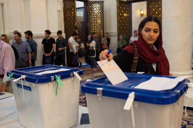 People cast their votes in the Iranian presidential election in Tehran on Saturday. Photo by Ali Mohammadi/UPI
