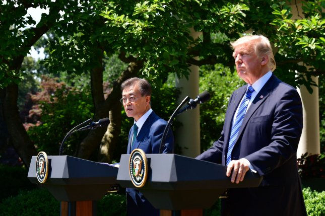 President Donald Trump (R) and South Korean President Moon Jae-in deliver remarks to the press in the Rose Garden at the White House in Washington, D.C. on Friday. The two said they agreed on a strategy to eliminate North Korea's nuclear program. Photo by Kevin Dietsch/UPI