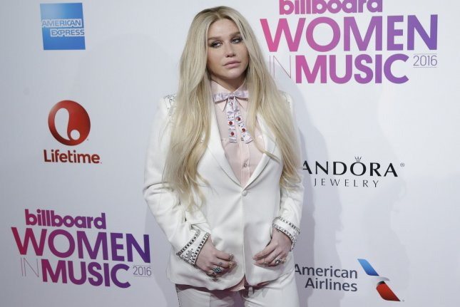 Kesha arrives on the red carpet at the Billboard Women in Music 2016 event on December 9. Kesha has released a new single titled Praying with an accompanying music video. File Photo by John Angelillo/UPI