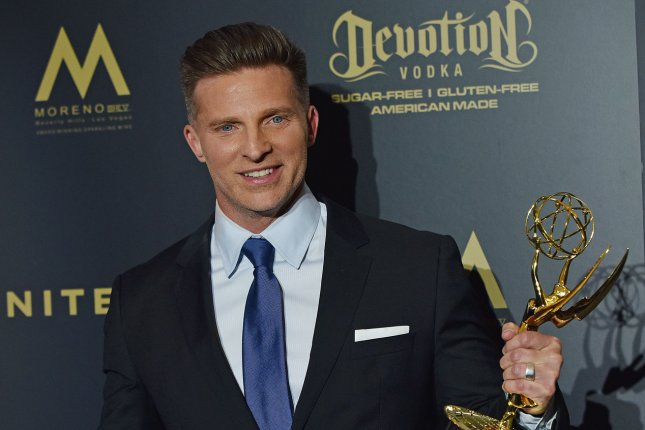 Steve Burton holds up his Daytime Emmy for Outstanding Supporting Actor in a Drama Series backstage in the press room during the 44th Annual Daytime Emmy Awards at the Pasadena Civic Auditorium on April 30. The actor has returned to General Hospital after a five-year hiatus. File Photo by Christine Chew/UPI