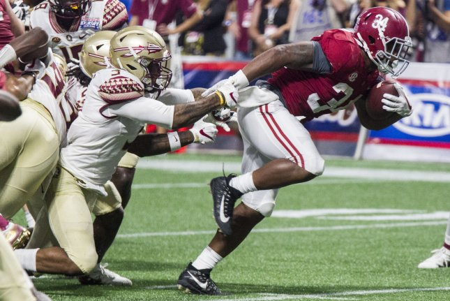 Florida State defensive back Derwin James (3) attempts to stop Alabama running back Damien Harris on his way into the end zone in the second half of the Chick-fil-A Kickoff game on September 2, 2017 at Mercedes-Benz Stadium in Atlanta, Georgia. Photo by Mark Wallheiser/UPI
