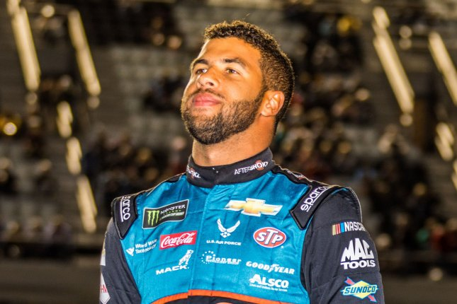 Bubba Wallace enjoys the moment before the start of the Gander RV Duel at Daytona 1 qualifying race for the 2019 Daytona 500 earlier this year. Wallace told reporters Friday he has recently been battling depression. File Photo by Edwin Locke/UPI