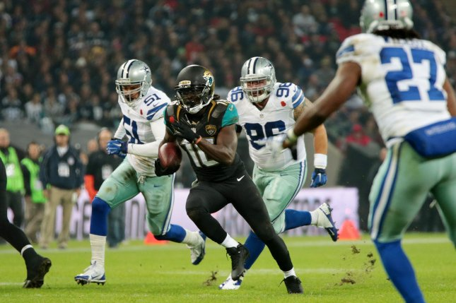 Former Jacksonville Jaguars running back Denard Robinson (16) will work under offensive coordinator Jay Gruden as the franchise's new offensive quality control coach. File Photo by Hugo Philpott/UPI