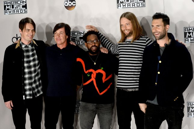 Left to right, musicians Mickey Madden, Matt Flynn, PJ Morton, James Valentine and Adam Levine of Maroon 5 appear backstage during the 2016 American Music Awards in Los Angeles. Madden has announced he is taking a break from the band.  File Photo by Jim Ruymen/UPI