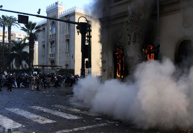 Egyptians throw stones during clashes with security forces in the administrative heart of Cairo Dec. 17, 2011. UPI/Mohamad Hosam