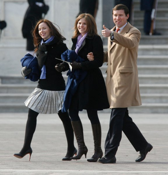 Former President George W. Bush's daughters, Barbara (L), Jenna (C) and her husband Henry Chase Hager gesture to friends at they leave the Barak Obama Inauguration Ceremony on Capitol Hill in Washington on January 20, 2009. (UPI Photo/John Anderson)